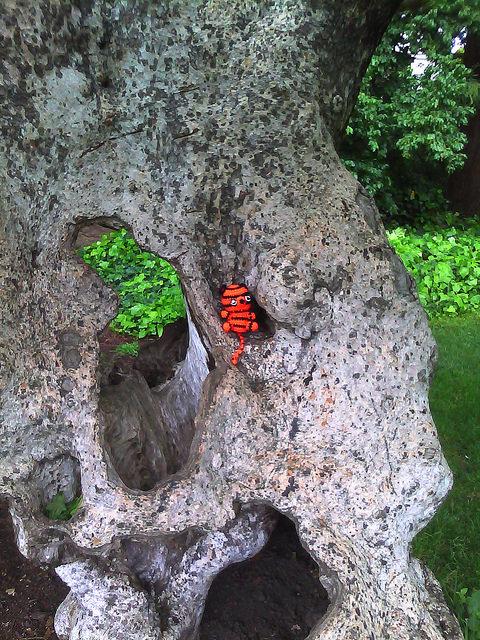 amigurumi crochet tiger in a tree