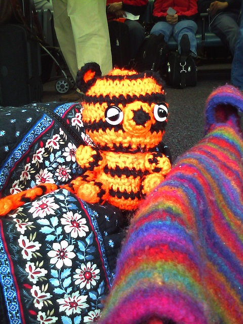 Boo-Boo the crochet tiger and traveling companion at O'Hare Airport