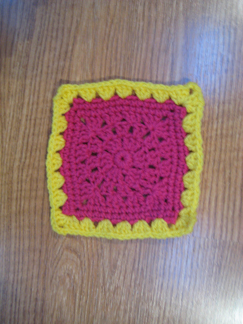 Crochet square E-2, a pink crochet square with a yellow granny shell border