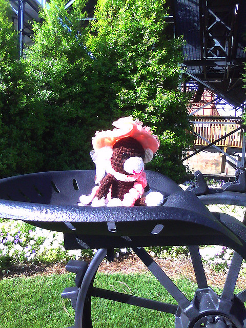crochet monkey in a tractor seat