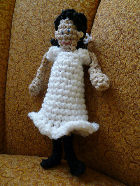 crochet doll on a chair