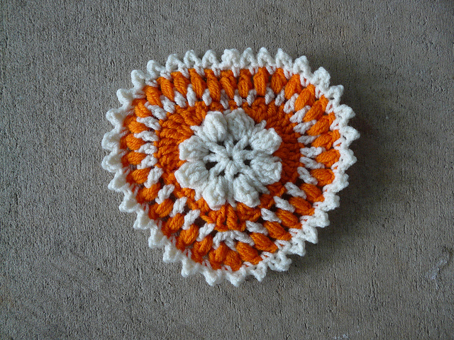 Orange and white textured crochet heart