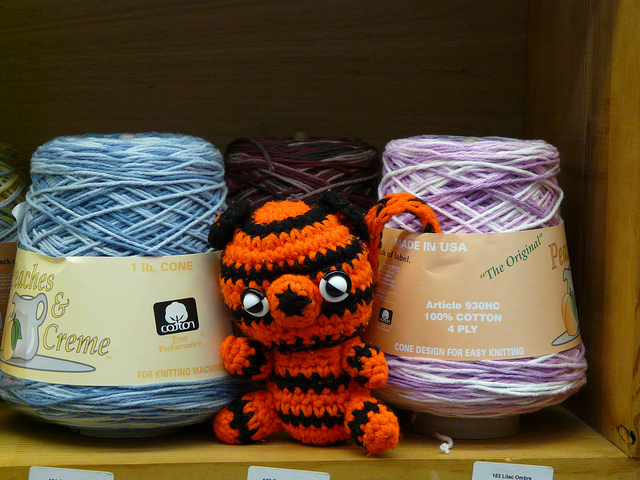 crochet tiger inspecting cotton yarn