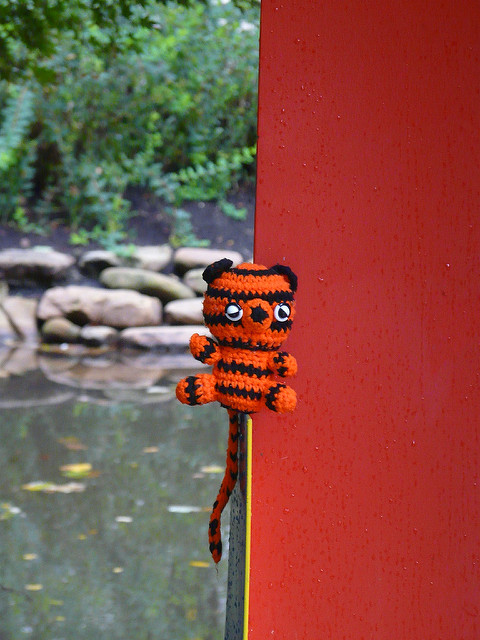 Boo-Boo the crochet tiger magically hovering on an outdoor sculpture as he oversees my countdown to the state fair