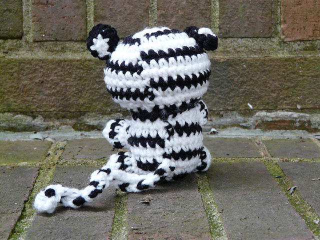 back view of white crochet tiger crochet amigurumi tiger