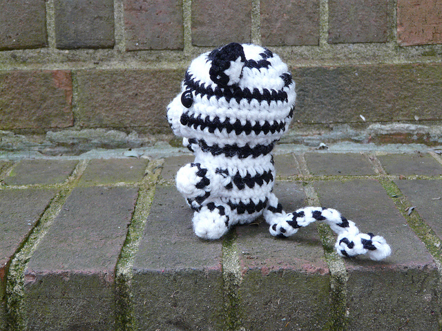 side view of white crochet tiger crochet amigurumi tiger