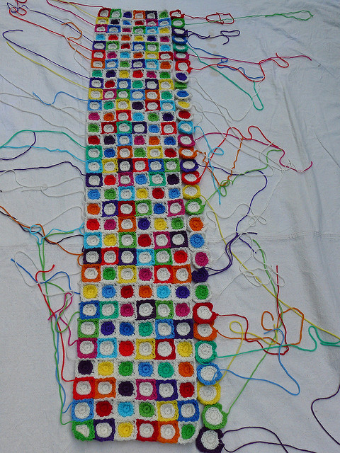 Seven rows of crochet squares with a crochet circle center