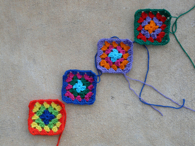 Four new granny squares worked one square at a time