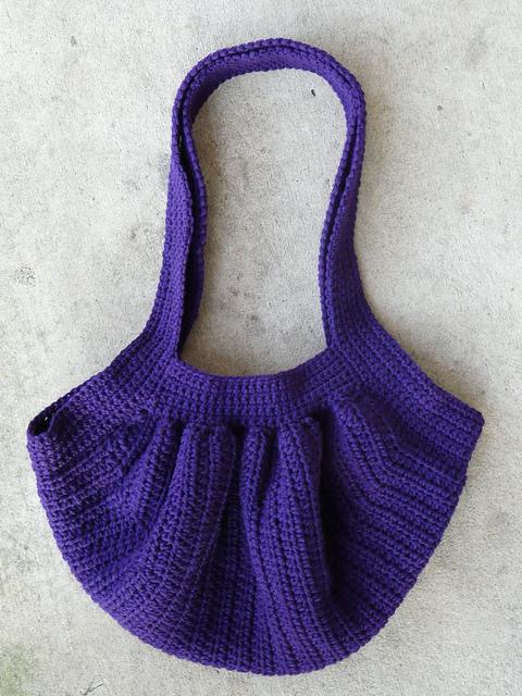 The finished purple crochet fat bag