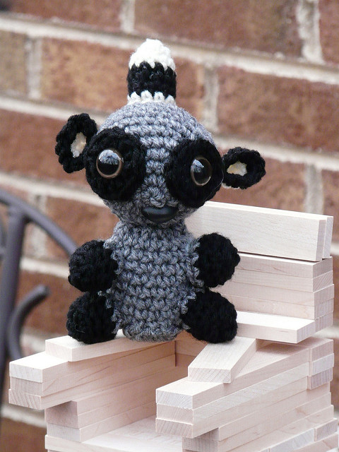a amigurmi lemur on a throne