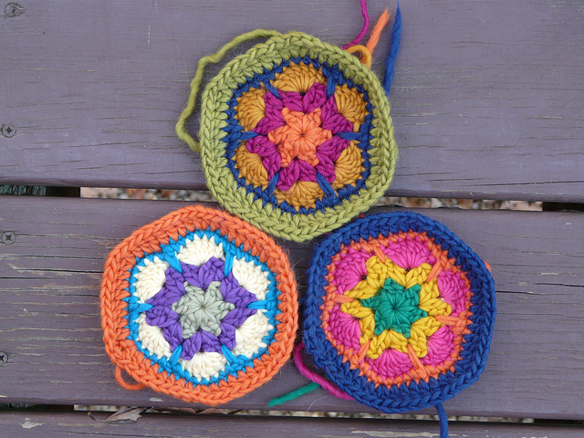 crochetbug, crochet flowers, crochet hexagons, crochet hexagon flower motif, lamb's pride wool, crochet rug