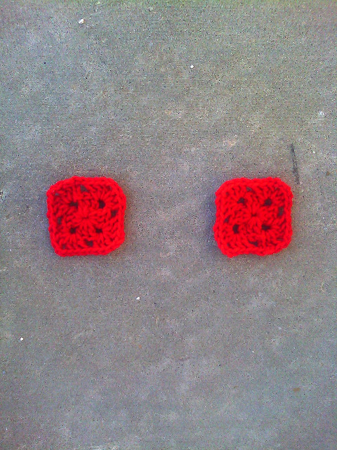 "Two cherry red two-round granny squares born of the thought experiment ""If Josef Albers crocheted"""