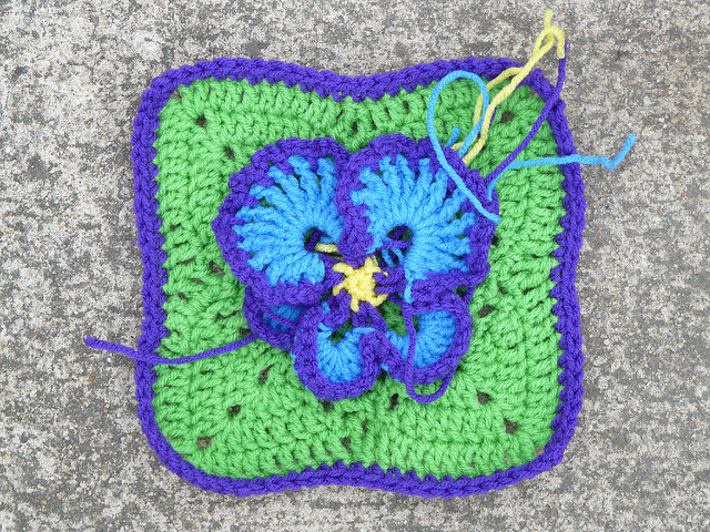 Crochet square with a crochet pansy
