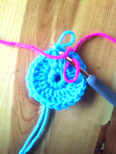 making a slip stitch to prepare for overlay crochet post stitches