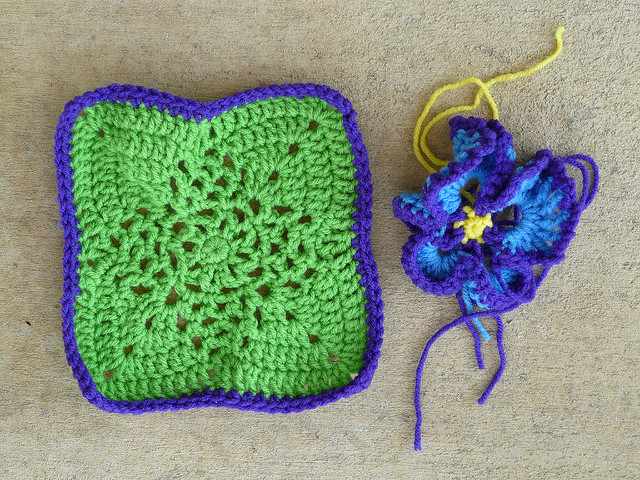 Bright green crochet square and a crochet flower to be appliqued