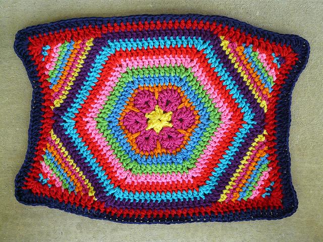 a crochet hexagon pet mat based on a crochet flower design