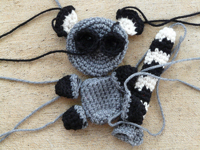 The crochet pieces of an amigurumi lemur ready to be assembled