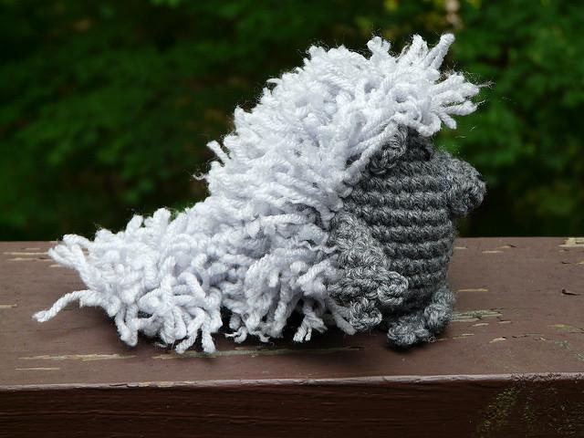 an amigurumi porcupine with added yarn fur