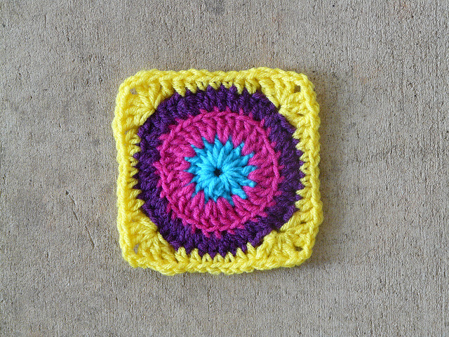A fourth and final round for crochet square 57 crocheted in yellow