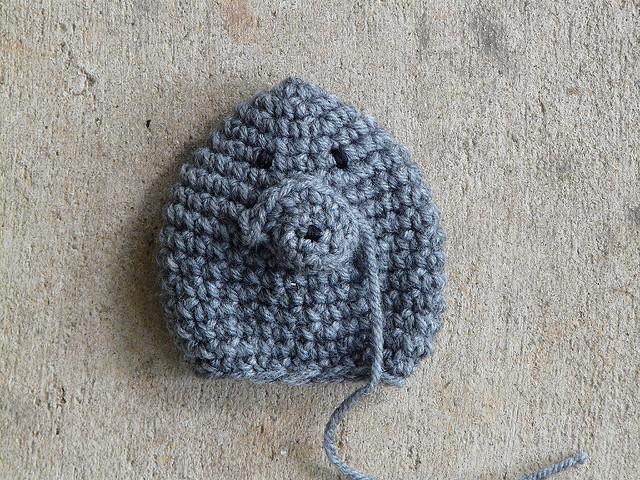 an amigurumi porcupine with a face