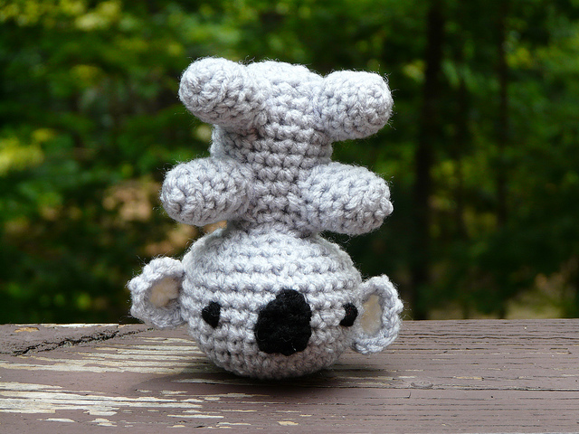 Leonard the amigurumi koala does a headstand in celebration of the first day of summer