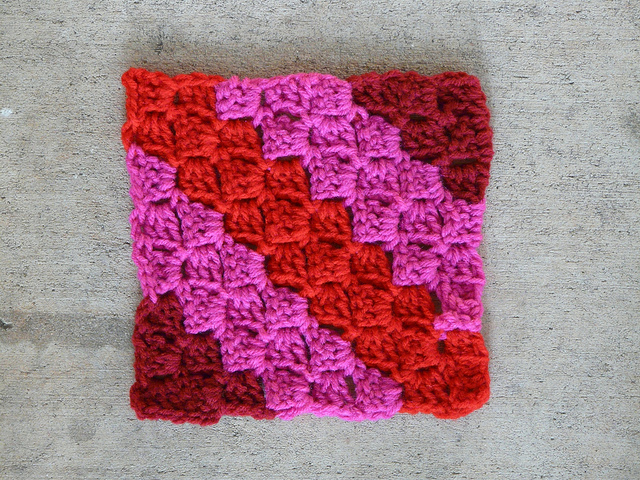 c2c crochet square in burgundy, pink, and red Square 10 which I did do, because there is no try