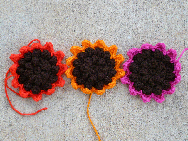 three crochet sunflowers