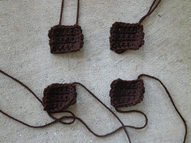 Four Bauhaus crochet squares