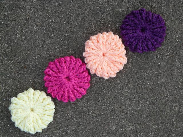 four crochet yo-yos