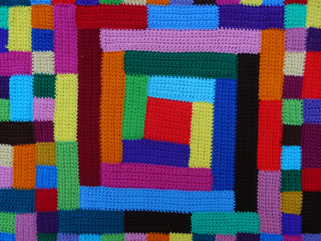 the center of a crochet blanket inspired by quilts