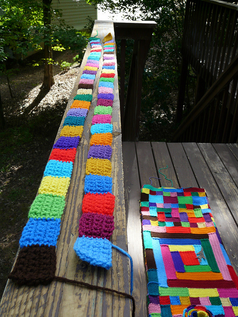 strips of crochet squares progress by accretion