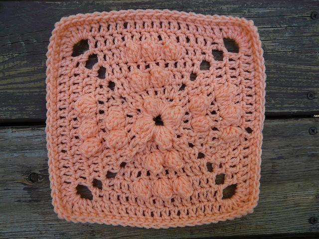Peach crochet square with bobbles