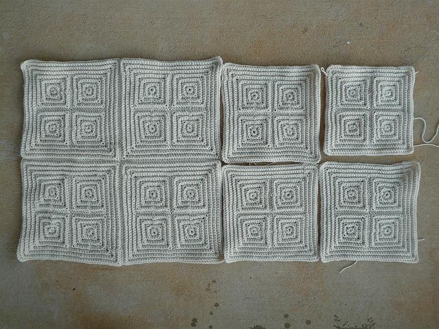 seven medium textured crochet squares and a four patch of small textured crochet squares