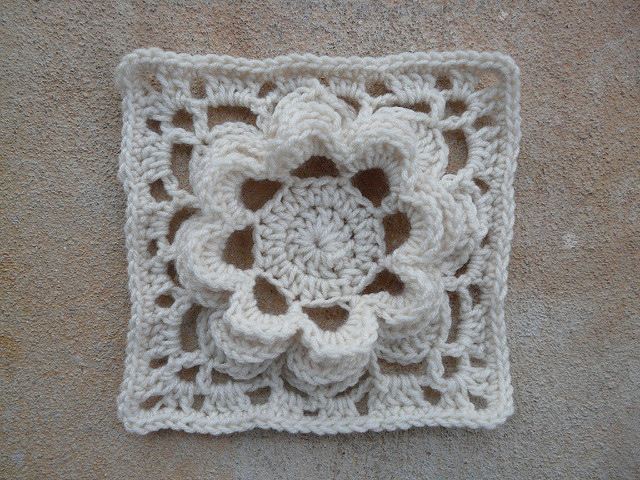 Square 17 a crochet square with a crochet flower in the center