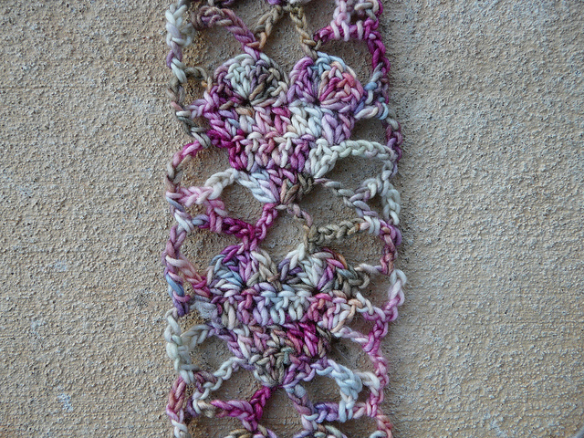 A detail of Alice Merlino's crochet heart scarf