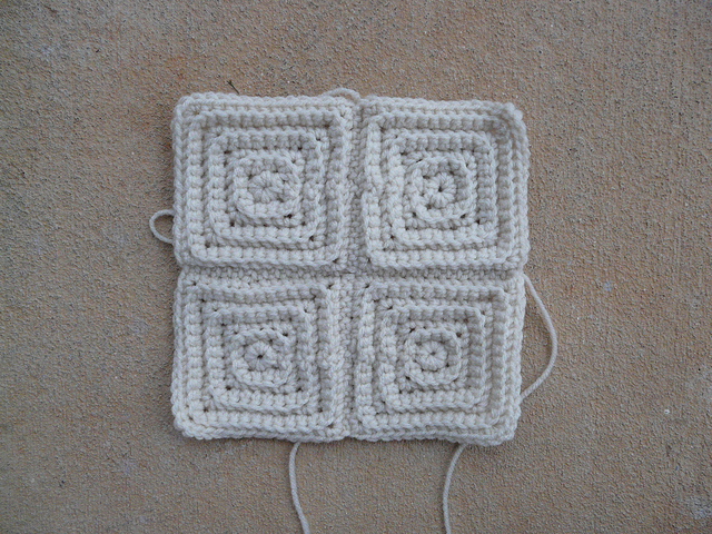 four textured crochet squares joined into one crochet square
