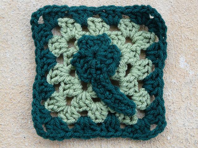 Crochet granny square with shamrock appliqué