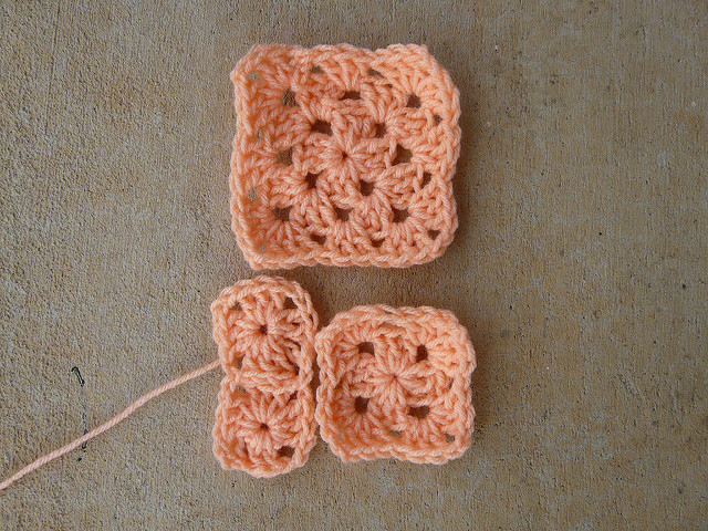 four granny squares in assorted sizes