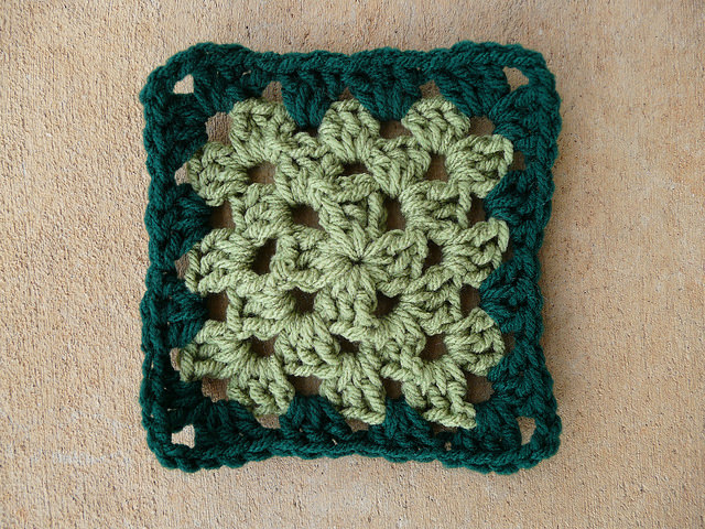 Crochet granny square with a light and dark green