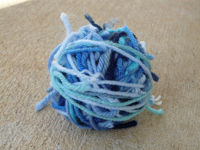 A scrap ball composed entirely of blue scraps from my Little Boy Blue blanket