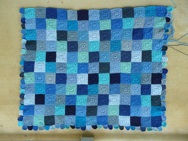 I finish adding border squares to the third side of the crochet blanket