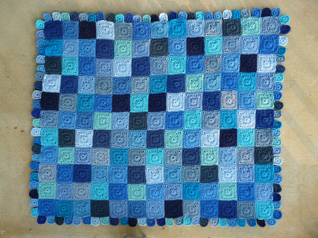 The Little Boy Blue crochet blanket with the border all done