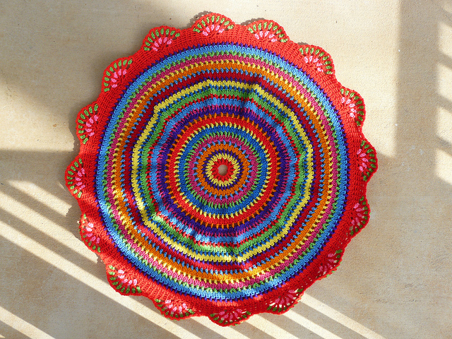 the front of a circular crochet table cloth based on a crochet african beads pattern