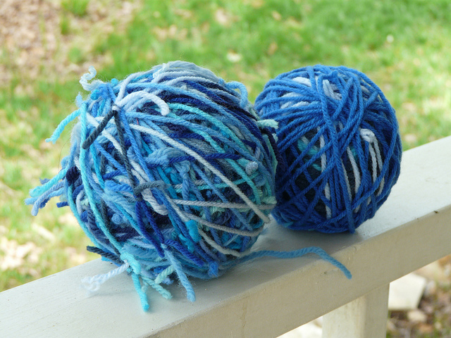 yarn balls made from yarn scraps tied with a square knot