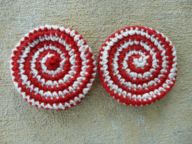 two spiral crochet cookies