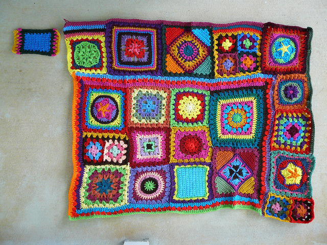 crochet granny squares made into a crochet blanket using a join as you go technique