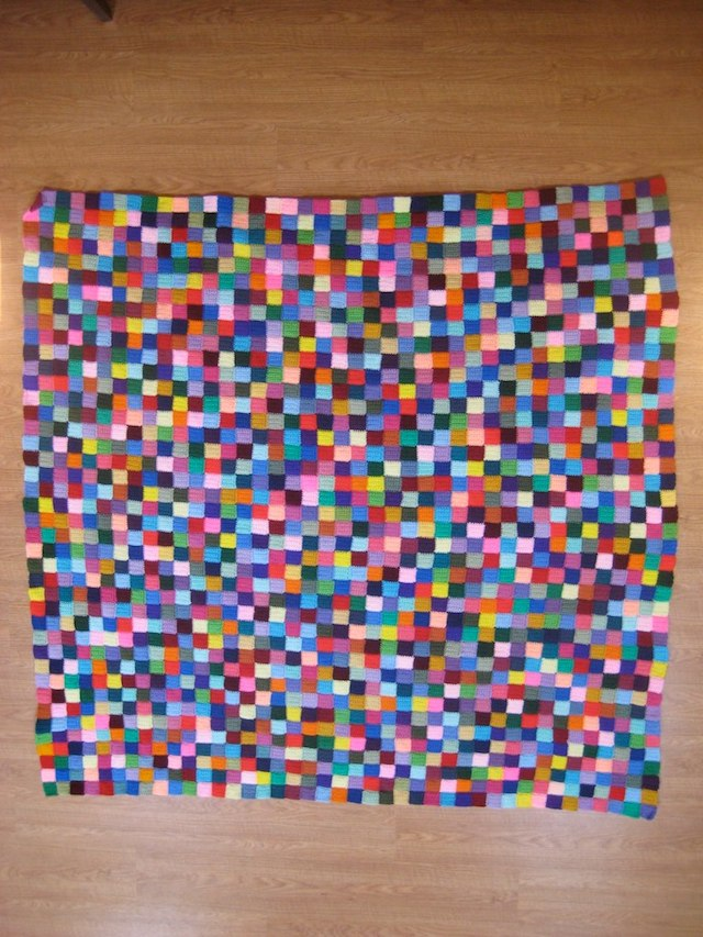 A crochet blanket or pixelghan made from 1681 crochet squares