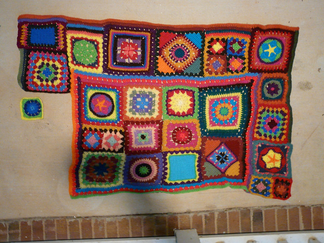 The beach blanket to-be with crochet square E-4 in place and ready to be joined weather or not