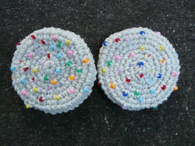 Two crochet sugar cookies