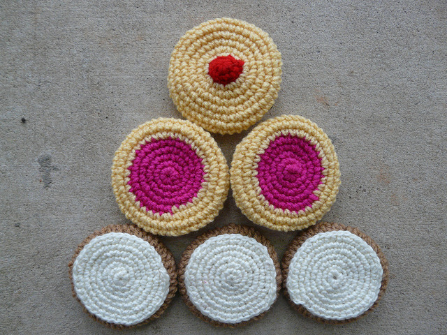 A pyramid of six crochet cookies completed as part of a challenge to myself